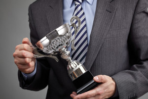 Businessman celebrating with trophy award for success in busines
