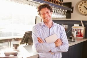 Bigstock Male Restaurant Owner Holding 94341125 300x200